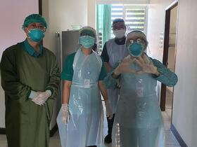gowned nurses and doctors