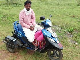 Mr Nagamanikam on his motorcycle